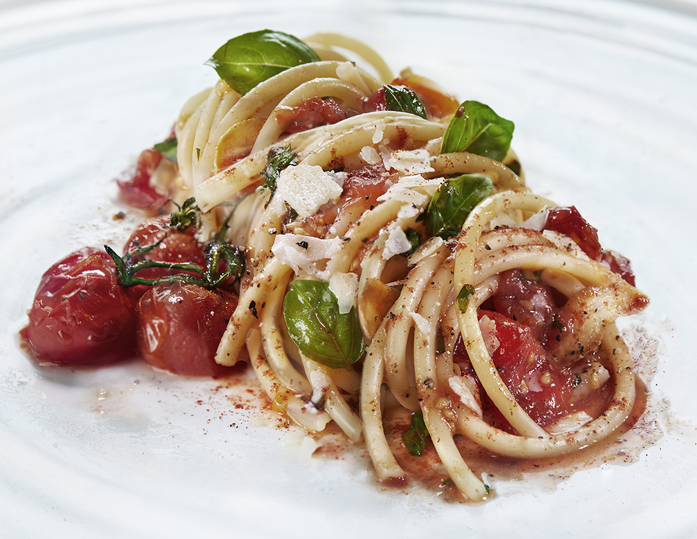 Classic roasted cherry tomato and basil sauce tossed with bucatini, finished with shaved parmesan