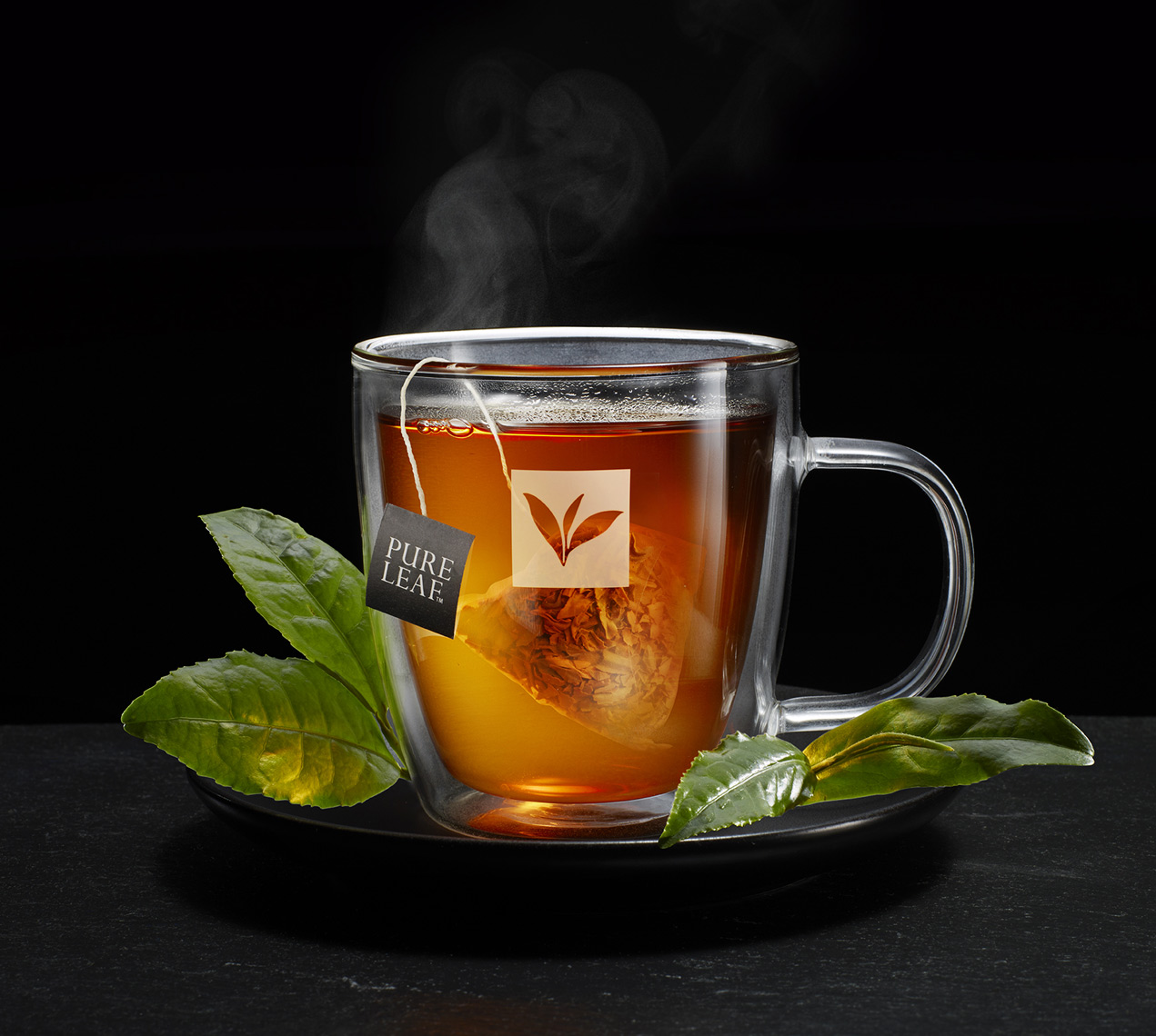 Steaming hot Black Vanilla tea in clear cup