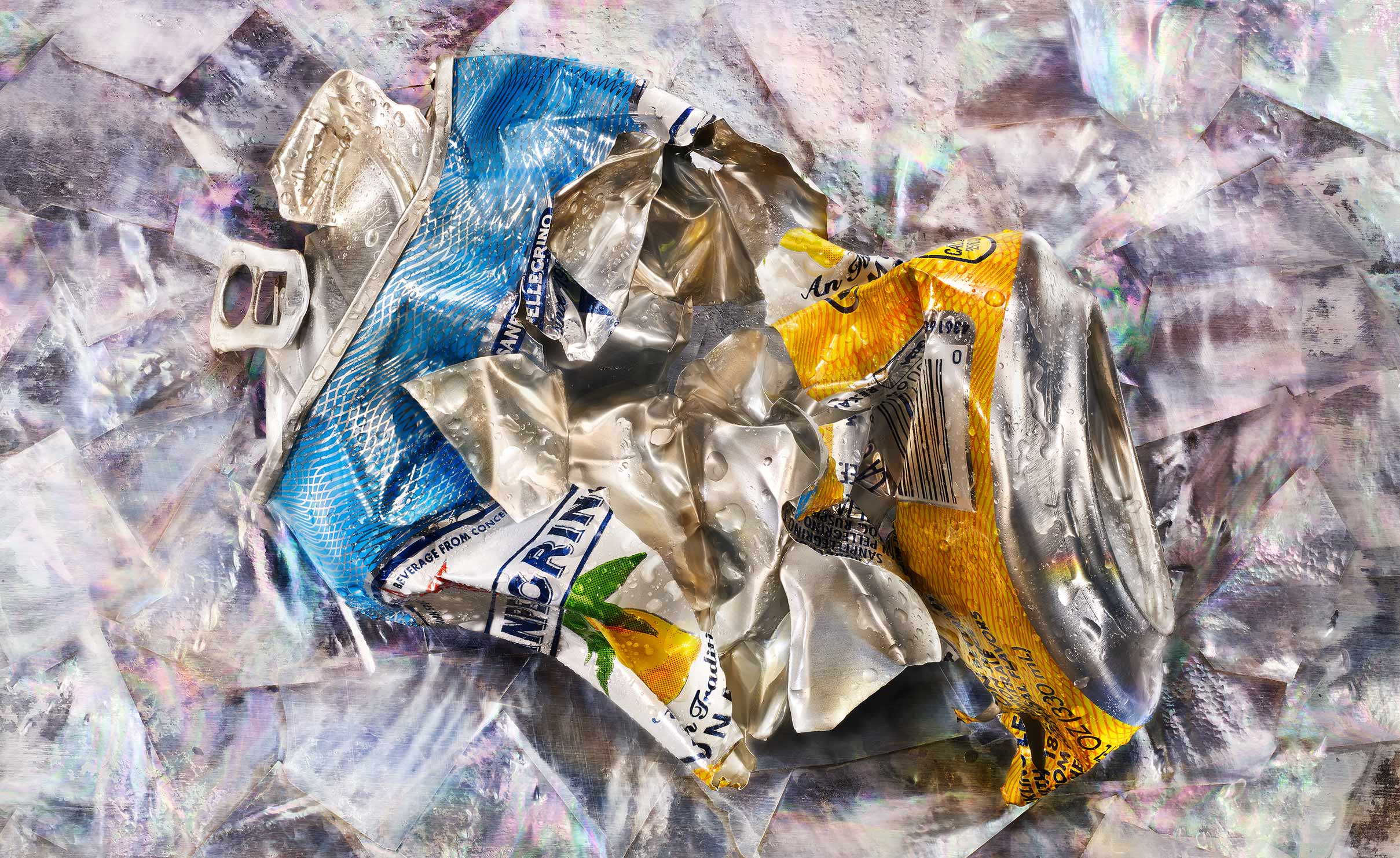 One crushed Lemonata aluminum metal soda can on white backgroundSanpellegrino1WEB