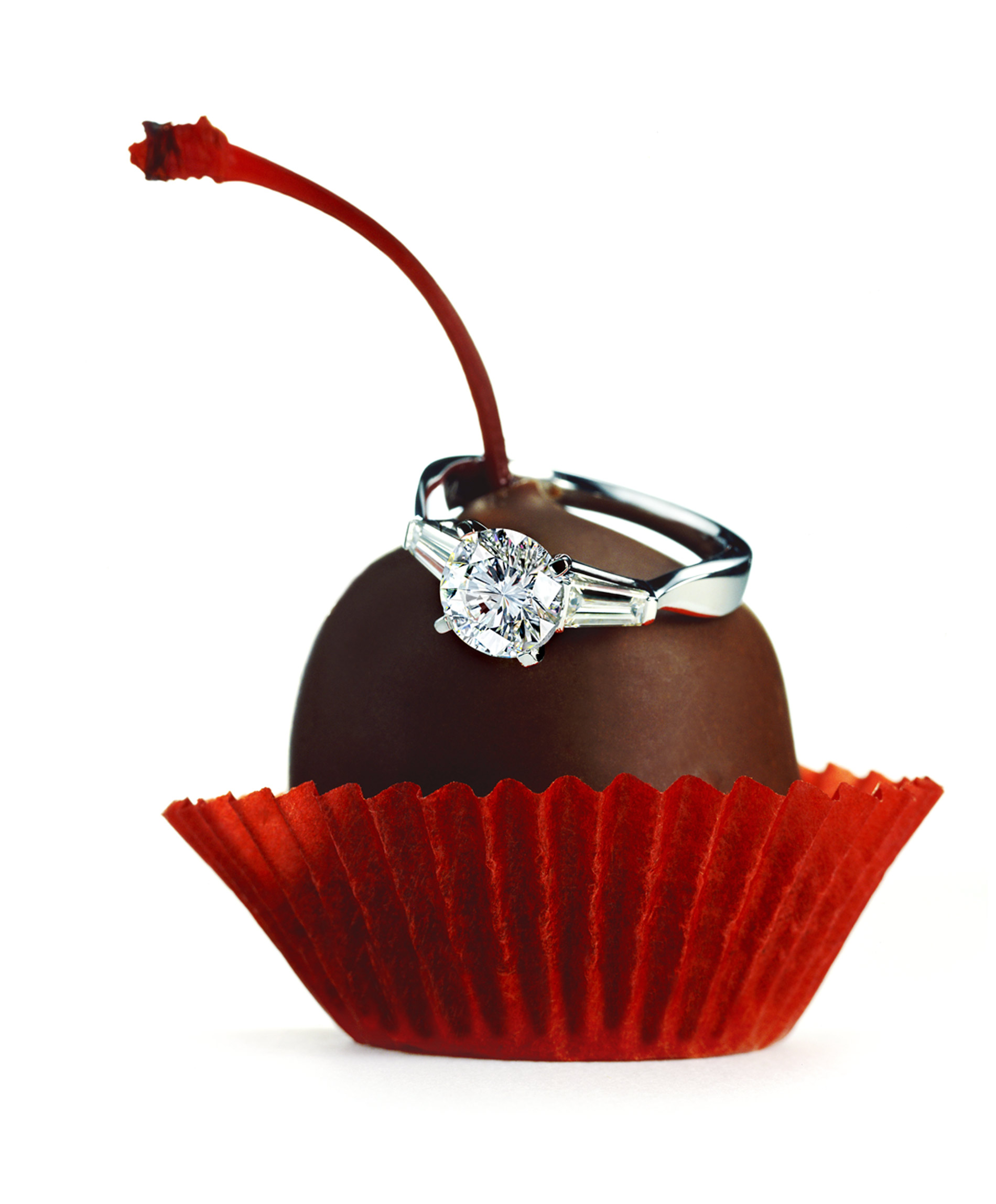 Diamond ring jewlery on a Godiva chocolate cherry cordial