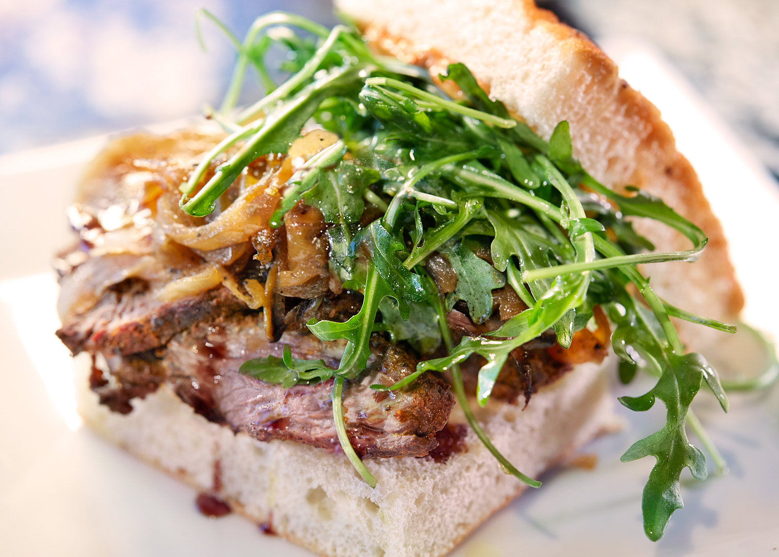 Roast Beef sandwich at The Chef and I restaurant in Nashville with balsamic onions and arugula on garlic focaccia.