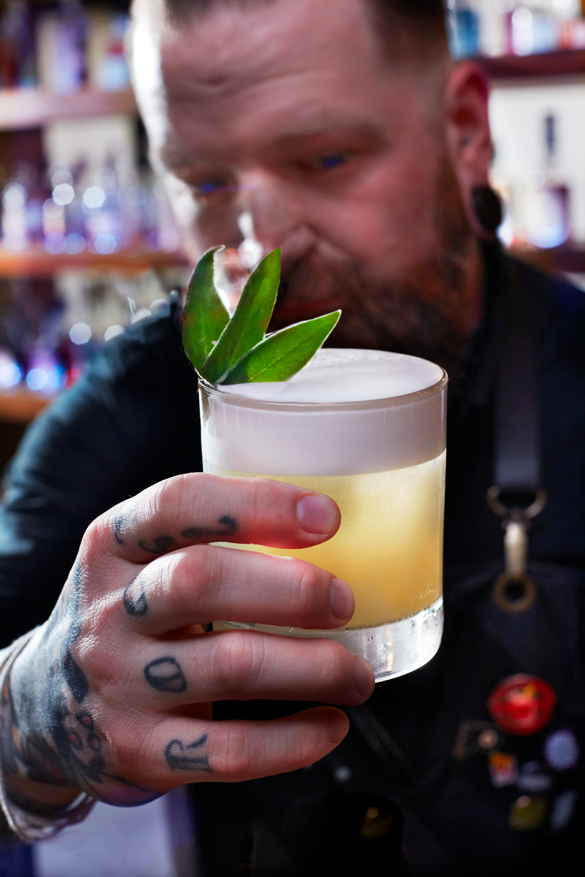 Sinema Restaurant Whiskey Sour cocktail with hand Tattoo